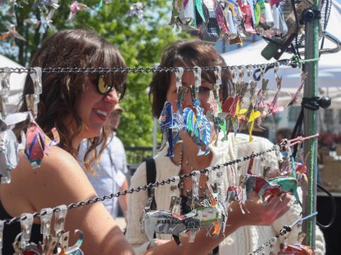 Browsing handcrafted creations at Panoply Arts Festival in Huntsville, Alabama